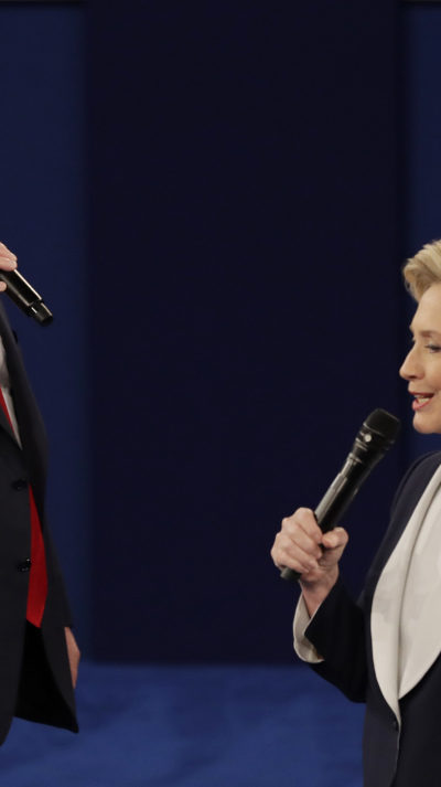 Republican presidential nominee Donald Trump and Democratic presidential nominee Hillary Clinton speak during the second presidential debate at Washington University in St. Louis, Sunday, Oct. 9, 2016. (AP Photo/Patrick Semansky)