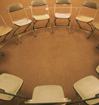 Empty folding chairs in circle