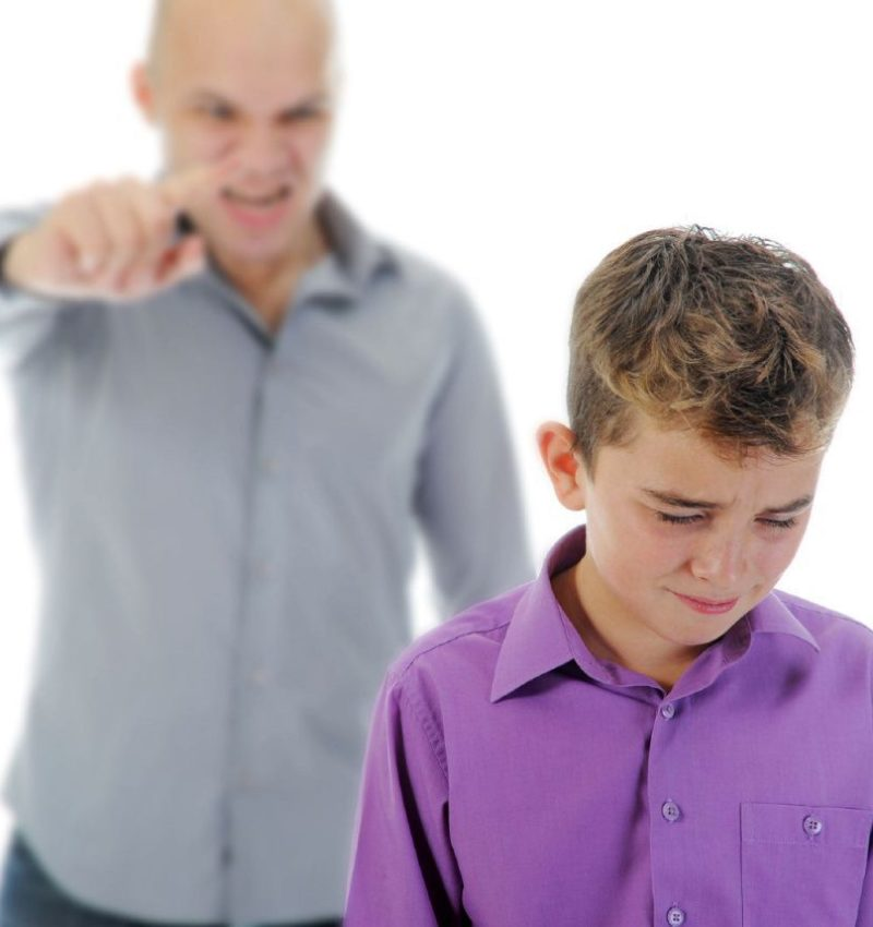 Strict father punishes his son. Isolated on white background. Photo taken on: November 06th, 2011