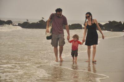 family-walking-on-beach